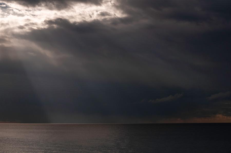 cloud_opening_over_the_ocean